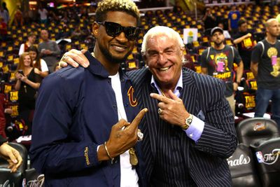 Usher and Rick Flair. (Getty)