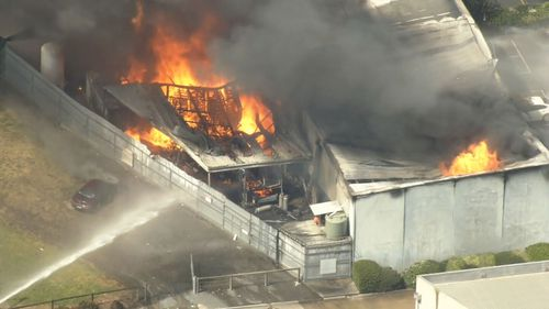 The blaze was deemed under control about 4pm, however more combustible material inside the factory later ignited.