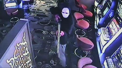 Three armed robbers threatened hotel staff with a firearm and a machete.