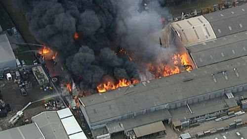 A massive fire has engulfed a factory in Revesby. (9NEWS)