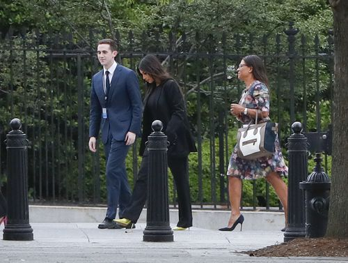 Kim Kardashian arrives at the White House with her aides. Picture: AP