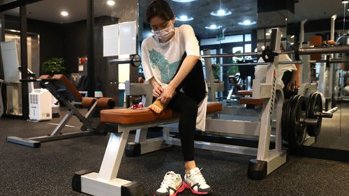 A woman works out at Chungwoon Sporex gym in Seoul, South Korea, where new restrictions have been imposed in gyms.