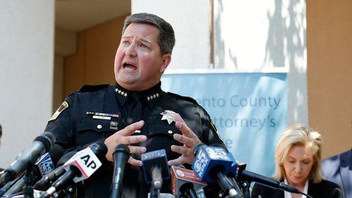 Sacramento County Sheriff Scott Jones (L) responds to reporter's questions after Mr DeAngelo's arrest was announced. (EPA)