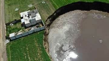 The sinkhole is threatening this home and the occupants have been evacuated. central mexico