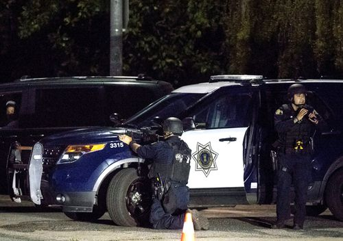 Police stay focused on a target after a deadly shooting at the Gilroy Garlic Festival in Gilroy, California.