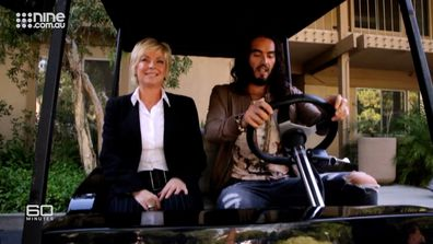 Russell Brand takes Liz Hayes for spin around the movie set.
