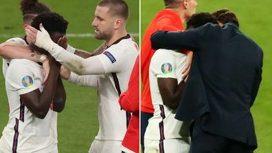 Bukayo Saka is comforted by teammates after missing the decisive penalty.