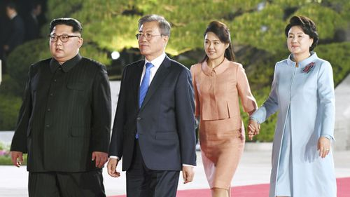 Kim and Mr Moon, Kim's wife Ri Sol Ju and Moon's wife Kim Jung Sook walk to the venue of a farewell event. (AP)