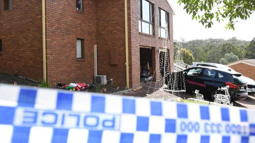 Tupperware cars and Christmas lights at the scene of the fatal balcony collapse. (AAP)