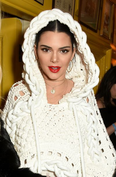 Kendall Jenner opted for classic beauty with a bold red lip. Eyes were lined with black Kohl for a sexy, defined look.
