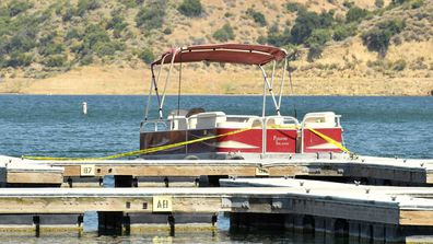A boat is docked and roped off with police tape at Lake Piru, where actress Naya Rivera was reported missing Wednesday, on July 9, 2020 in Piru, California. According to the Ventura County Sheriff's Department this is believed to the boat that was rented by Rivera.