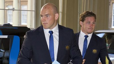 Bruised and battered Aussie pair Stephen Moore and Michael Hooper arrive at Buckingham Palace. (Getty)