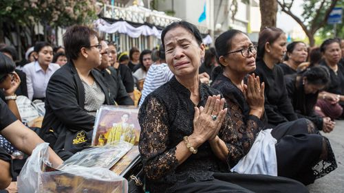Grieving Thailand salutes late king