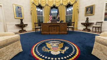 Joe Biden redecorates Oval Office for first day on the job