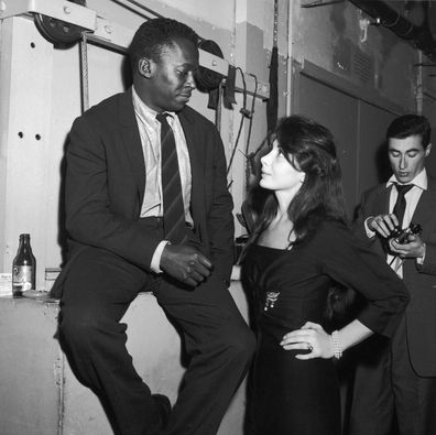 Juliette Greco and Miles Davis at the club Saint Germain In Paris, France in 1958