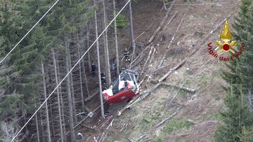 Rescuers worked by the wreckage of a cable car after it collapsed near the summit of the Stresa-Mottarone line in the Piedmont region, northern Italy.