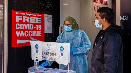 A health worker is seen in a medical centre in Lakemba in Sydney which offers COVID-19 vaccines.