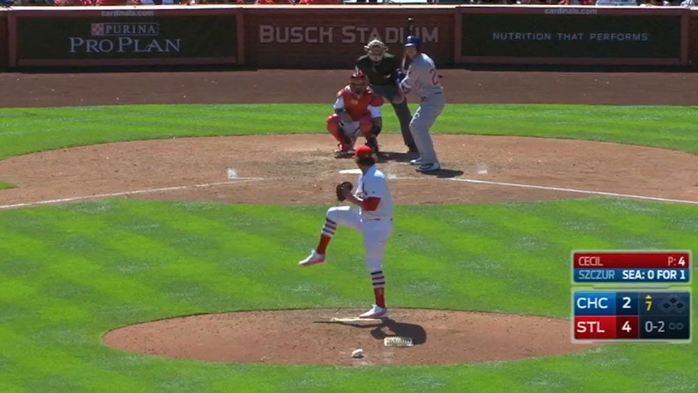 St Louis Cardinals catcher Yadier Molina can't find baseball stuck to his chest protector