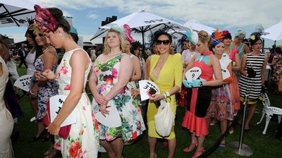 Queuing up for the Fashions on the Field. (AAP)