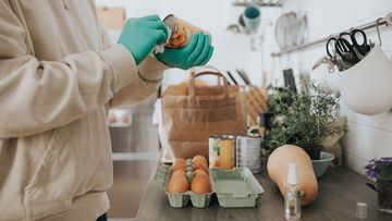 Health authorities in the US say  there's no real risk of getting the virus from grocery bags or takeout boxes but recommend washing your hands.