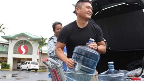 Residents are stocking up on essentials are they prepare for Lane to reach Hawaii.