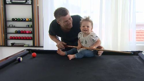 David Warner with daughter Ivy. (9NEWS)