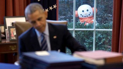 It may well be the most serious job in the world, but White House photographer Pete Souza has captured some of the lighter moments of Barack Obama's presidency, like this moment showing the president in the Oval Office seemingly being stalked by a snowman. (All photos: White House)
