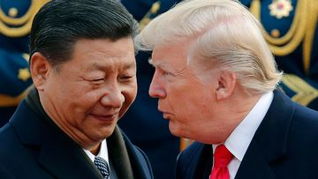 US President Donald Trump chats with Chinese President Xi Jinping during a welcome ceremony at the Great Hall of the People in Beijing, in 2017.