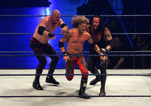 Wrestling fighters Kane (L), Edge (C) and Undertaker (R) fight during the WWE Smackdown Wrestling at Arena Monterrey on May 9, 2010 in Monterrey, Mexico.