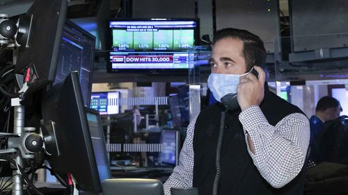 The Dow Jones Industrial Average broke through the 30,000 mark for the first time.