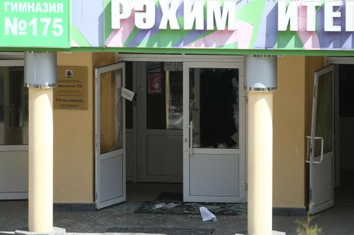 KAZAN, RUSSIA  MAY 11, 2021: Shattered glass by the entrance to school No 175 where two attackers opened fire; at least one teacher and eight students are reported dead. Yegor Aleyev/TASS (Photo by Yegor AleyevTASS via Getty Images)