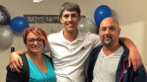 Christopher Cassaniti celebrating his 18th birthday with his parents.