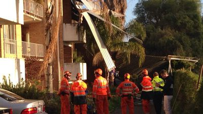 SES crews at an Attadale apartment complex where a roof has been ripped off. (9NEWS)