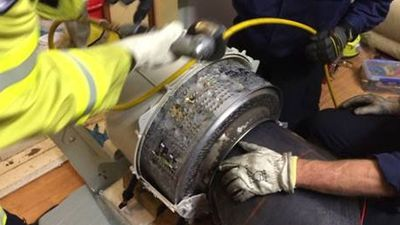 """The crew had never performed a washing machine rescue before, and they decided to disassemble the machine around the patient. <br><br> """"Once the exterior of the washing machine had been removed fire fighters had to cut away the stainless steel drum to remove the patient from the washing drum,"""" they said. <br><br>"""