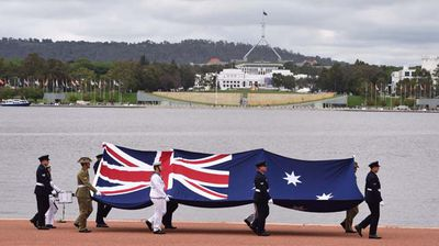 Australia Day gets underway in Canberra with a military flag ceremony. (AAP)