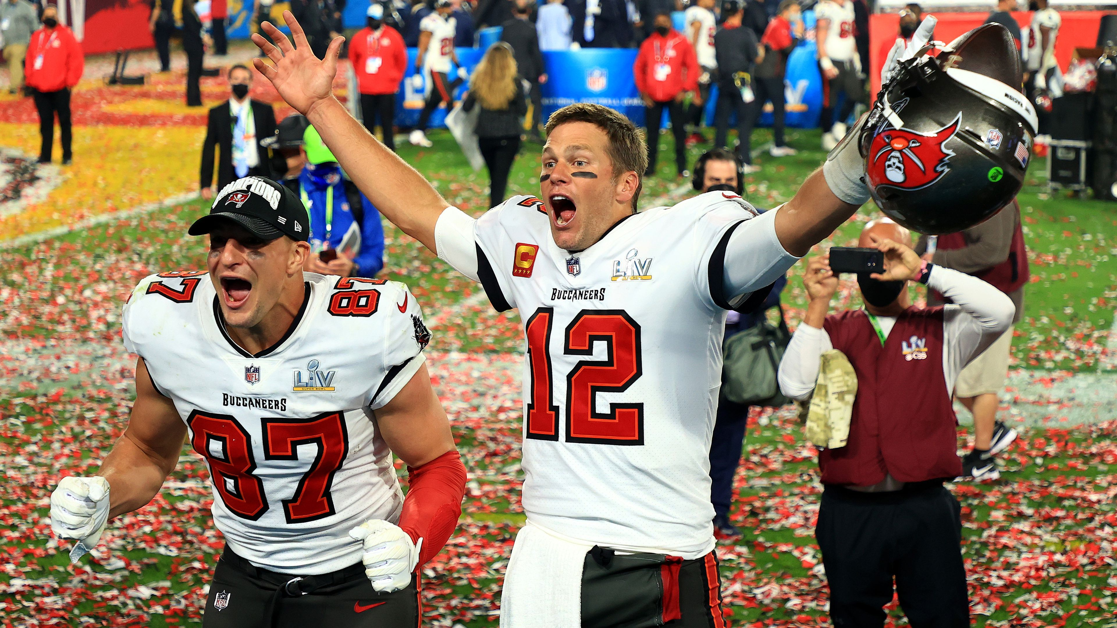 TAMPA, FLORIDA - FEBRUARY 07: Rob Gronkowski #87 and Tom Brady #12 of the Tampa Bay Buccaneers celebrate after defeating the Kansas City Chiefs in Super Bowl LV at Raymond James Stadium on February 07, 2021 in Tampa, Florida. The Buccaneers defeated the Chiefs 31-9. (Photo by Mike Ehrmann/Getty Images)