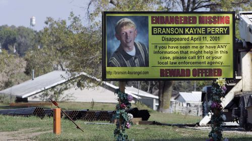 A billboard in Skidmore implores passers-by for help finding Branson Perry.