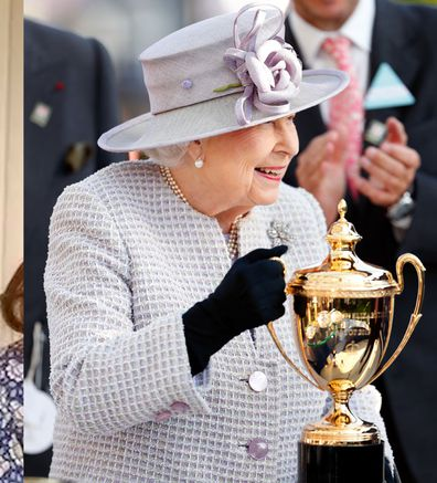 Queen Elizabeth II presents the Queen Elizabeth II Stakes trophy as she attends QICPO British Champions Day at Ascot Racecourse on October 19, 2019 in Ascot, England.