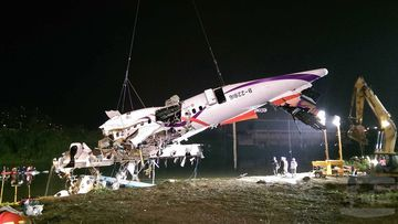 "<p _tmplitem=""1"">At least 25 people were killed yesterday when a passenger plane operated by TransAsia Airways clipped an overpass soon after take-off and plunged into a river in Taiwan, the airline's second crash in seven months.</p> <p _tmplitem=""1"">The rescue operation continued into the night, with a crane lifting the rear and central sections of the plane from the water, with one body retrieved from inside. (AAP)</p>"