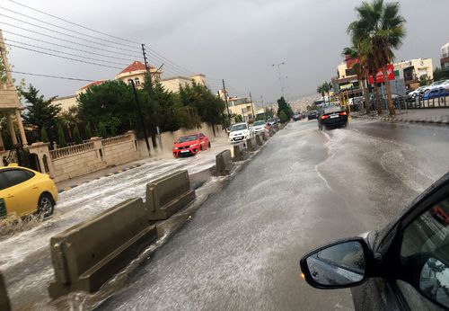 A flooded street in the city of Amman in Jordan after a sudden downpour.