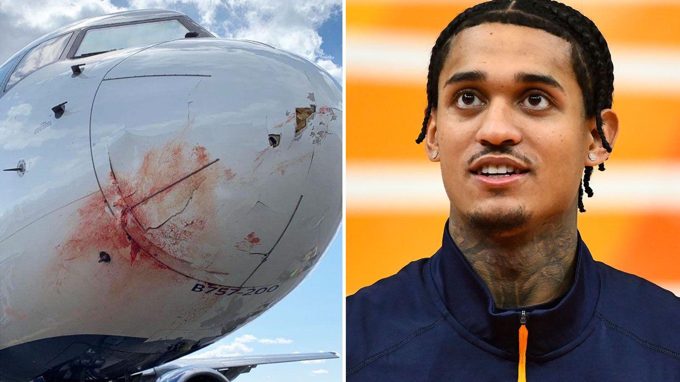 A plane the Utah Jazz were on struck a flock of birds, forcing an emergency landing. (Getty/Twitter)