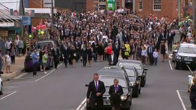 Local residents, the cricket community and fans of all ages followed Hughes on a procession through the streets of his beloved hometown. (9NEWS)