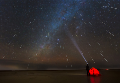 Geminids meteor shower in 2018 over lake in Erenhot, Inner Mongolia, China.