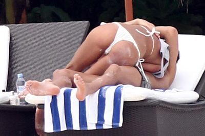 That's soccer spunk Christiano Ronaldo underneath his new Russian girlfriend in the Maldives.