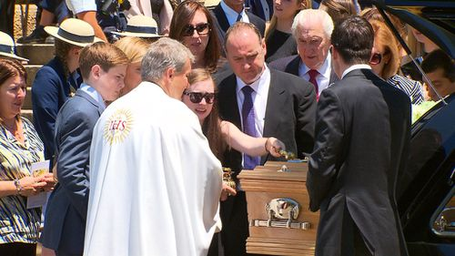 More than 1000 people gathered for Bartter's funeral. (AAP)
