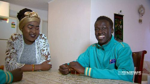 Deng with his sister Margaret. Picture: 9NEWS