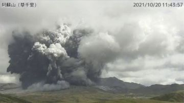 In this image taken by a surveillance camera released by Japan Meteorological Agency, smokes rise from the No. 1 Nakadake crater of Mr. Aso after its eruption, observed from Kusasenri, southwestern Japan, Wednesday, Oct. 20, 2021. The eruption occurred at 11:43 a.m., according to the agency. (Japan Meteorological Agency via AP)