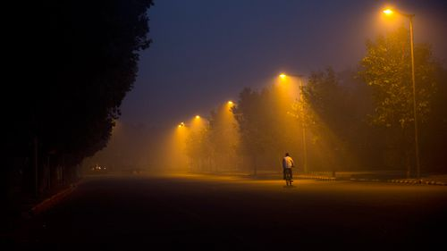 A cyclist pedals through the morning smog a day after Diwali festival, in New Delhi, India. (AP)