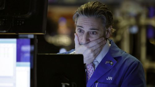 Trader John Romolo works on the floor of the New York Stock Exchange today.