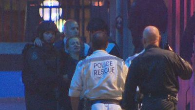 One woman was carried down the street by paramedics. (9NEWS)